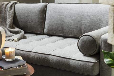 close up of a grey swyft sofa